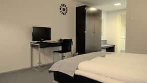 Desk, blackout curtains, free cots/infant beds, rollaway beds
