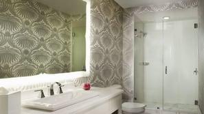 Designer toiletries, hair dryer, bathrobes, towels