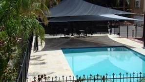 Outdoor pool, open 7 AM to 9 PM, pool loungers