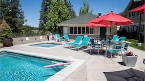 Seasonal outdoor pool, open 9:00 AM to 5:00 PM, pool umbrellas