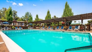Seasonal outdoor pool, open 7:00 AM to 10:00 PM, pool umbrellas
