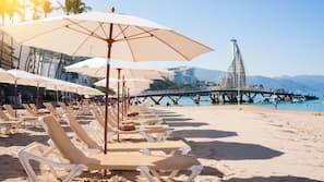 On the beach, beach umbrellas, beach towels