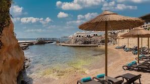 Sun loungers, beach umbrellas, beach towels
