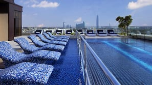 5 outdoor pools, open 6:00 AM to 10:00 PM, pool loungers
