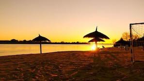 Private beach, beach umbrellas, beach volleyball, kayaking