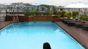 Seasonal outdoor pool, open 11:00 AM to 7:00 PM, pool umbrellas