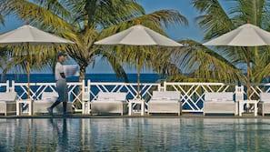 Outdoor pool, an infinity pool, pool umbrellas