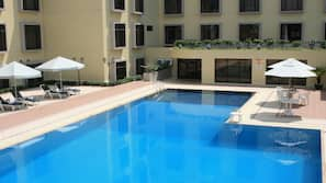Outdoor pool, open 6:30 AM to 11:30 PM, pool umbrellas