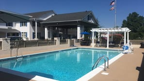 Seasonal outdoor pool, open 8:00 AM to 8:00 PM, pool umbrellas
