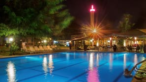2 outdoor pools, open 7:00 AM to 10:00 PM, pool umbrellas