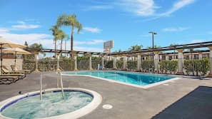 Outdoor pool, open 9:00 AM to 10:00 PM, pool umbrellas