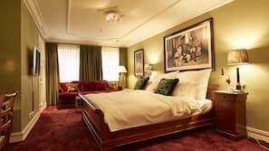 Luxe beddengoed, donzen dekbedden, pillowtop-bedden, een laptopwerkplek