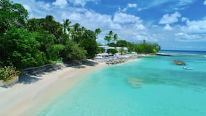 On the beach, white sand, beach towels, snorkelling