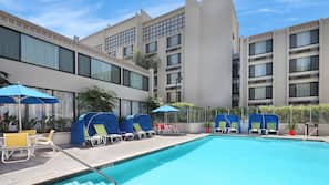 Outdoor pool, open 9 AM to 10 PM, free pool cabanas