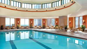 Indoor pool, open 7:00 AM to 10:00 PM, pool loungers