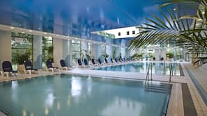 4 indoor pools, open 7:00 AM to 10:00 PM, pool loungers