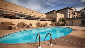 Outdoor pool, open 10:00 AM to 6:00 PM, pool umbrellas, sun loungers