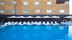 Outdoor pool, open 7 AM to 11 PM, cabanas (surcharge), pool umbrellas
