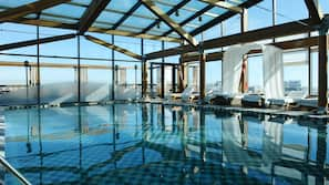 Indoor pool, open 7:00 AM to 9:00 PM, pool umbrellas, sun loungers