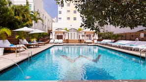 Outdoor pool, open 8 AM to 8 PM, pool cabanas (surcharge), pool loungers