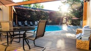 Seasonal outdoor pool, open 10 AM to 10 PM, pool umbrellas