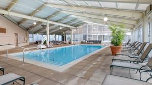 Indoor pool, pool umbrellas, sun loungers