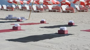 On the beach, beach cabanas, sun loungers, beach umbrellas