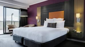 Premium bedding, down comforters, pillowtop beds, minibar