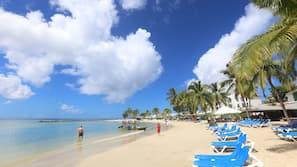 On the beach, beach umbrellas, beach towels, scuba diving