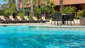 Outdoor pool, open 6 AM to 10 PM, sun loungers