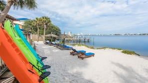 Beach nearby, white sand, sun loungers, beach umbrellas