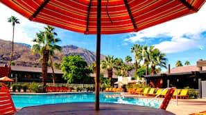 Outdoor pool, open 8 AM to midnight, free pool cabanas, pool umbrellas