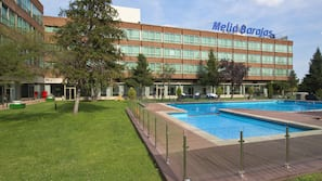 Seasonal outdoor pool, open 11 AM to 9 PM, pool loungers
