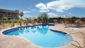 Seasonal outdoor pool, open 8:00 AM to 10:00 PM, pool umbrellas