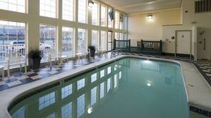 Indoor pool, open 9:00 AM to 11:00 PM, pool umbrellas