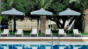 Indoor pool, seasonal outdoor pool, pool umbrellas, pool loungers
