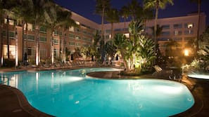 Outdoor pool, open 7:00 AM to 10 PM, pool umbrellas, sun loungers