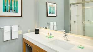Shower, designer toiletries, hair dryer