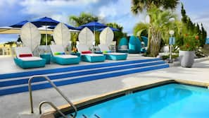Outdoor pool, open 8 AM to 10 PM, pool loungers
