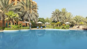 3 outdoor pools, open 8:00 AM to 10:00 PM, pool umbrellas, pool loungers