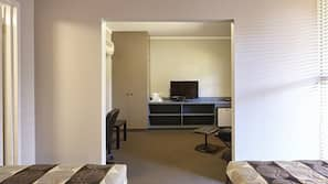 Desk, iron/ironing board, linens