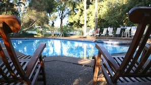 Outdoor pool, open 8 AM to 6 PM, pool loungers