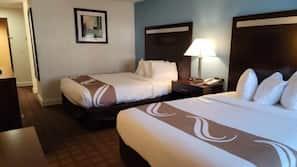 Premium bedding, pillowtop beds, laptop workspace, blackout drapes