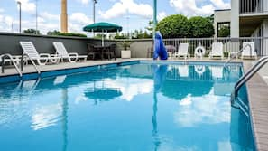 Outdoor pool, open 10 AM to 6:00 PM, pool umbrellas, sun loungers