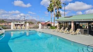 Seasonal outdoor pool, open 9:00 AM to 10:00 PM, pool umbrellas