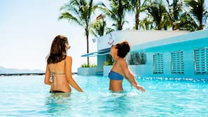 Outdoor pool, open 6:00 AM to 8:00 PM, pool cabanas (surcharge)