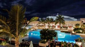 Outdoor pool, open 6:00 AM to 8:00 PM, cabanas (surcharge)
