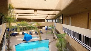 Indoor pool, open 9:00 AM to 10:00 PM, pool umbrellas, pool loungers