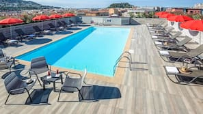 Outdoor pool, a heated pool, open 9:00 AM to 9:00 PM, pool umbrellas