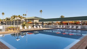 Outdoor pool, open 7:00 AM to 10:30 PM, pool umbrellas, sun loungers